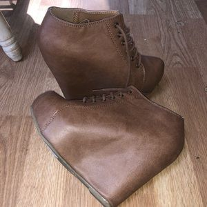 Medium brown, wedged lace up booties, size 6